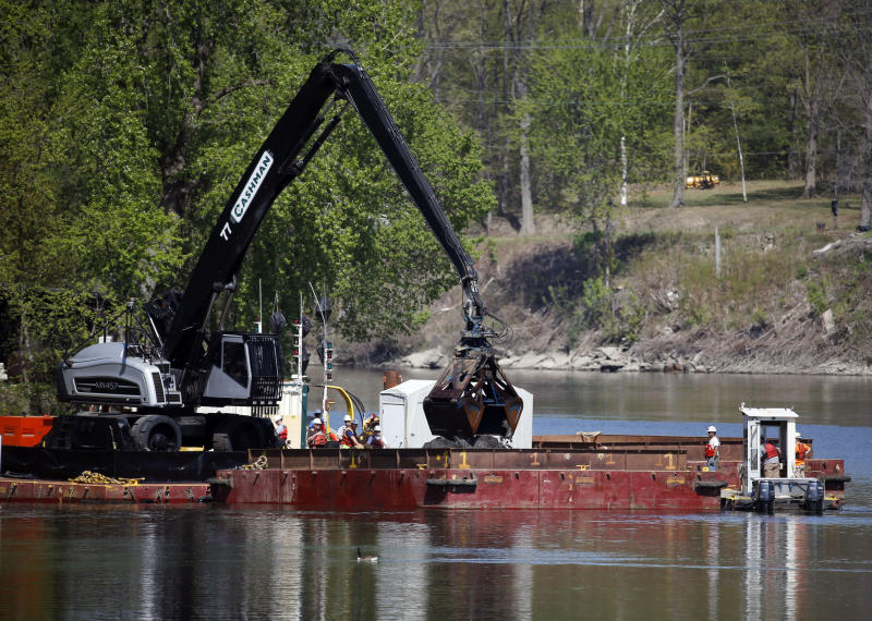 FILE- In this May 7, 2015 file photo, crews perform dredging work along the upper Hudson River in Waterford, N.Y. New York officials who are pushing for additional cleanup of the Hudson River followed through Wednesday, Aug. 21, 2019 on their promise of a lawsuit against the U.S. Environmental Protection Agency. The federal lawsuit seeks to overturn the EPA's decision in April not to compel General Electric to restart dredging for polychlorinated biphenyls from the upper river. Agency officials had said more time and testing are needed to fully assess the $1.7 billion Superfund cleanup. (AP Photo/Mike Groll, File)