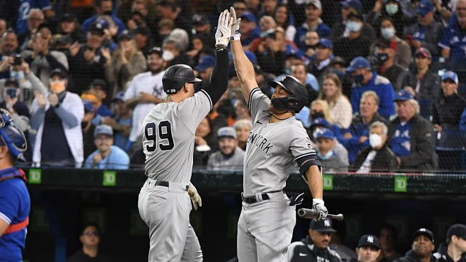 Aaron Judge and Giancarlo Stanton jumping elbow bump after Judge HR