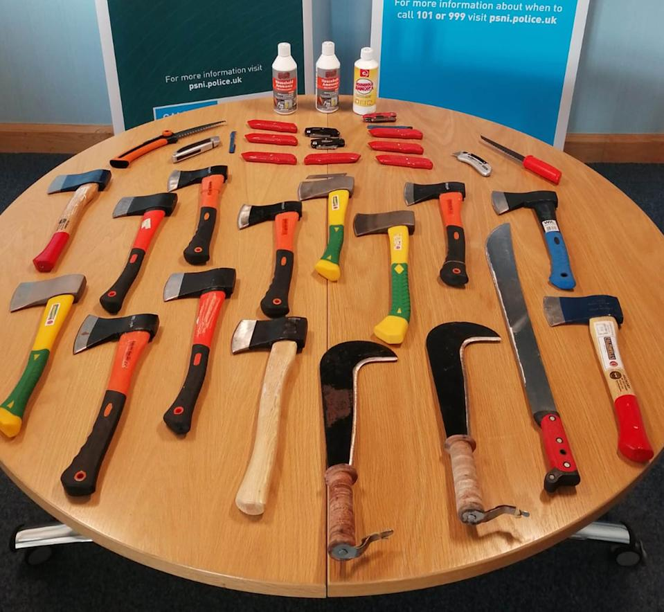 Hatchets and Stanley knives among weapons seized by the PSNI as police arrested two people after a disturbance at a funeral. (PA Images)