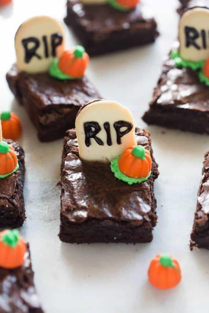 """<p>Black decorating gel and a few Milano cookies come together to create the adorable """"tombstones"""" you see here. If you're strapped for time, you could even use store-bought brownies as your base.</p><p><strong>Get the recipe at <a href=""""https://tastesbetterfromscratch.com/halloween-graveyard-brownies/"""" rel=""""nofollow noopener"""" target=""""_blank"""" data-ylk=""""slk:Tastes Better From Scratch"""" class=""""link rapid-noclick-resp"""">Tastes Better From Scratch</a>.</strong></p><p><strong><a class=""""link rapid-noclick-resp"""" href=""""https://go.redirectingat.com?id=74968X1596630&url=https%3A%2F%2Fwww.walmart.com%2Fsearch%2F%3Fquery%3Dthe%2Bpioneer%2Bwoman%2Bserving%2Bplatters&sref=https%3A%2F%2Fwww.thepioneerwoman.com%2Ffood-cooking%2Fmeals-menus%2Fg32110899%2Fbest-halloween-desserts%2F"""" rel=""""nofollow noopener"""" target=""""_blank"""" data-ylk=""""slk:SHOP SERVING PLATTERS"""">SHOP SERVING PLATTERS</a><br></strong></p>"""