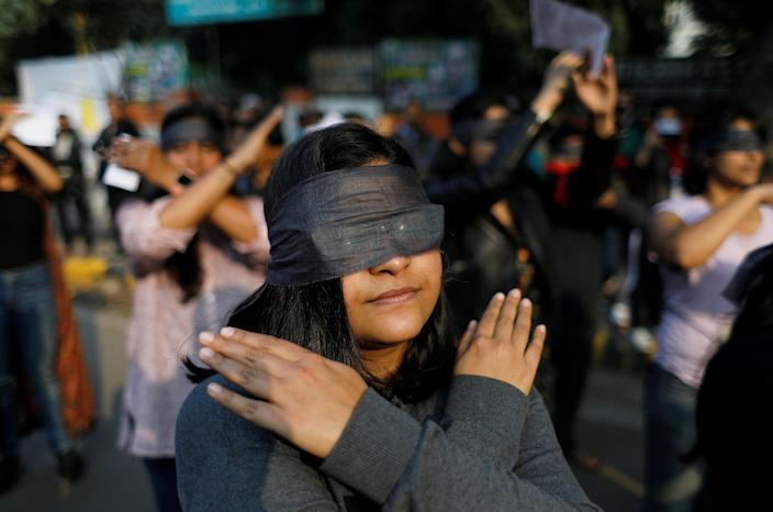 Protestors wearing blindfolds take part in a protest in solidarity with rape victims and to oppose violence against women in India, in New Delhi, India December 7, 2019. REUTERS/Adnan Abidi