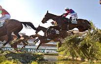 <p>One For Arthur takes the water jump before going on to win the Grand National at Aintree Racecourse. (Rex features) </p>