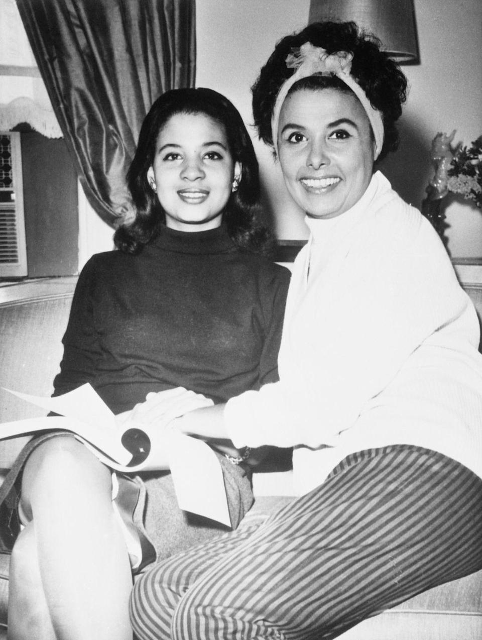 <p>Lena and her daughter, Gail Jones, hang out in the singer's Manhattan apartment in 1960. The dancer had two children, both born during her seven-year marriage to Louis Jordan Jones. </p>