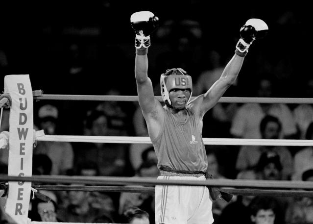 Pernell Whitaker of Norfolk, Va., raises his arms in victory after defeating Clifford Gray of Boynton Beach, Fla., in the Olympic boxing trials in Fort Worth, Texas, June 7, 1984. Whitaker won the fight by decision. (AP Photo/Carlos Osorio)