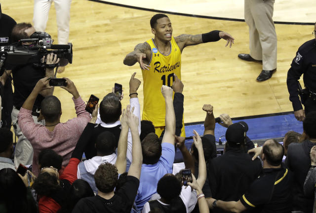 UMBC's Jairus Lyles celebrates with fans after the team's 74-54 win over Virginia on Friday. (AP)