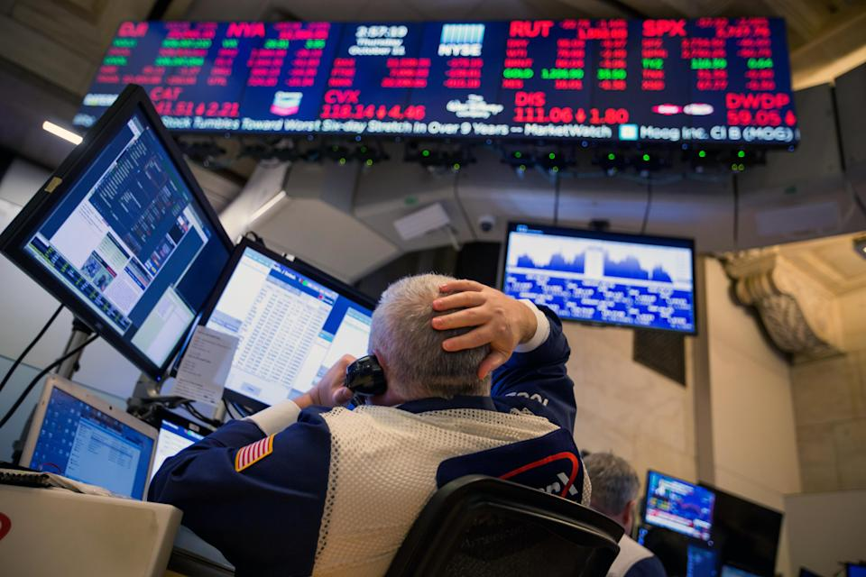 A trader works on the floor of the New York Stock Exchange (NYSE) in New York, U.S., on Thursday, Oct. 11, 2018. U.S. stocks fell for a sixth day, extending the longest losing streak of Donald Trump's presidency, as energy shares plunged and a rally in tech failed to lift the broader market. Photographer: Michael Nagle/Bloomberg via Getty Images