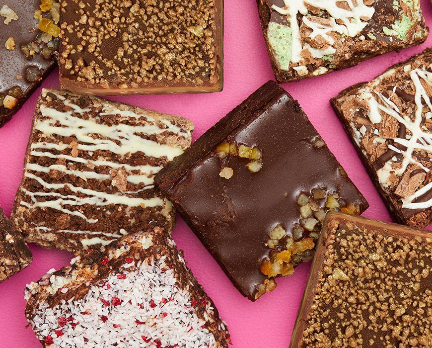 """<p>The guys over at Lola's Cupcakes also know a thing or two about making a delicious brownie, and this variety box proves just that. Expect a selection of flavours including chocolate orange, mint choc chip, millionaire shortbread and more. </p><p><a class=""""link rapid-noclick-resp"""" href=""""https://www.lolascupcakes.co.uk/Ordering/1800/variety-brownie-box.htm?gclid=CjwKCAiA17P9BRB2EiwAMvwNyBLevkw0KeKE9ADeaPPU4MUSgRTaNOISDZPJ92HGdz6JSb6hf05z7xoC7hoQAvD_BwE"""" rel=""""nofollow noopener"""" target=""""_blank"""" data-ylk=""""slk:BUY NOW"""">BUY NOW</a> <strong>£16.50</strong></p>"""