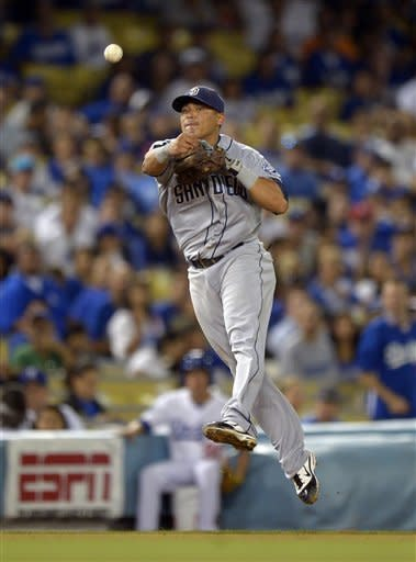 San Diego Padres shortstop Everth Cabrera attempts to throw out Los Angeles Dodgers' A.J. Ellis at first during the seventh inning of their baseball game, Tuesday, Sept. 4, 2012, in Los Angeles. Ellis was safe at first on the play. (AP Photo/Mark J. Terrill)