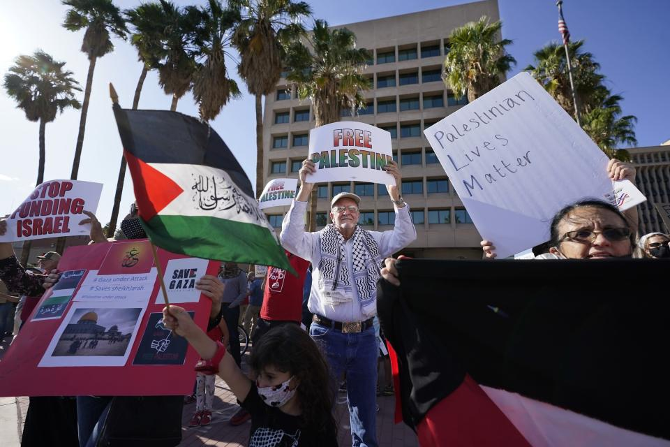Now 81 and retired, the Rev. John Fife III, who was pastor at Tucson's Southside Presbyterian Church, participates in a pro-Palestinian rally in Tucson, Ariz., on Monday, May 17, 2021. Southside and Fife hosted some 13,000 asylum seekers over most of the 1980s, with up to 100 sleeping on the floor every night. (AP Photo/Ross D. Franklin)