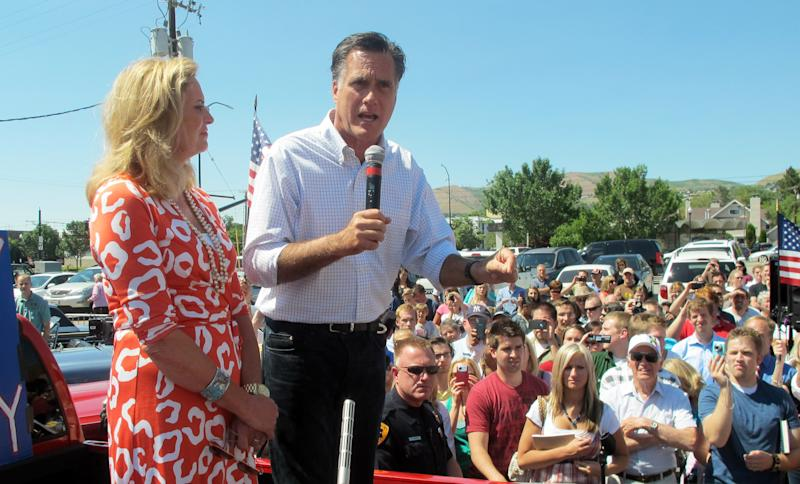 Former Massachusetts Gov. Mitt Romney and his wife, Ann, greet supporters at a drive-in hamburger restaurant in Salt Lake City,  on Friday June 24, 2011. Republican presidential hopeful Mitt Romney is criticizing President Barack Obama's economic policies as he makes campaign stops in his one-time home state of Utah. (AP Photo/Jennifer Dobner)