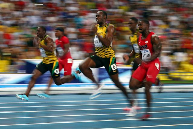 MOSCOW, RUSSIA - AUGUST 11: Usain Bolt of Jamaica (L) and Justin Gatlin of the United States compete in the Men's 100 metres Final during Day Two of the 14th IAAF World Athletics Championships Moscow 2013 at Luzhniki Stadium on August 11, 2013 in Moscow, Russia. (Photo by Cameron Spencer/Getty Images)