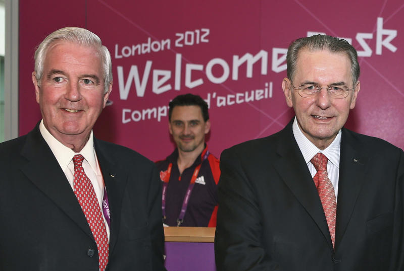 FILE -  This is a Friday July 20, 2012  file photo of IOC President Jacques Rogge,  and the IOC member for Britain Craig Reedie, on Rogge's arrival for the London 2012 Olympic Games at Heathrow Airport, London.  Seven months before the vote, an International Olympic Committee panel is setting off on a series of site-inspection visits that could prove influential in the race to host the 2020 Summer Games. The IOC's evaluation commission is heading to Japan this week on the first leg of its three-city tour to assess the bids from Tokyo, Madrid and Istanbul. Chaired by IOC Vice President Craig Reedie of Britain, the 14-member panel will meet with bid leaders and government officials and visit potential venues. (AP Photo Paul Gilham, Pool, File)