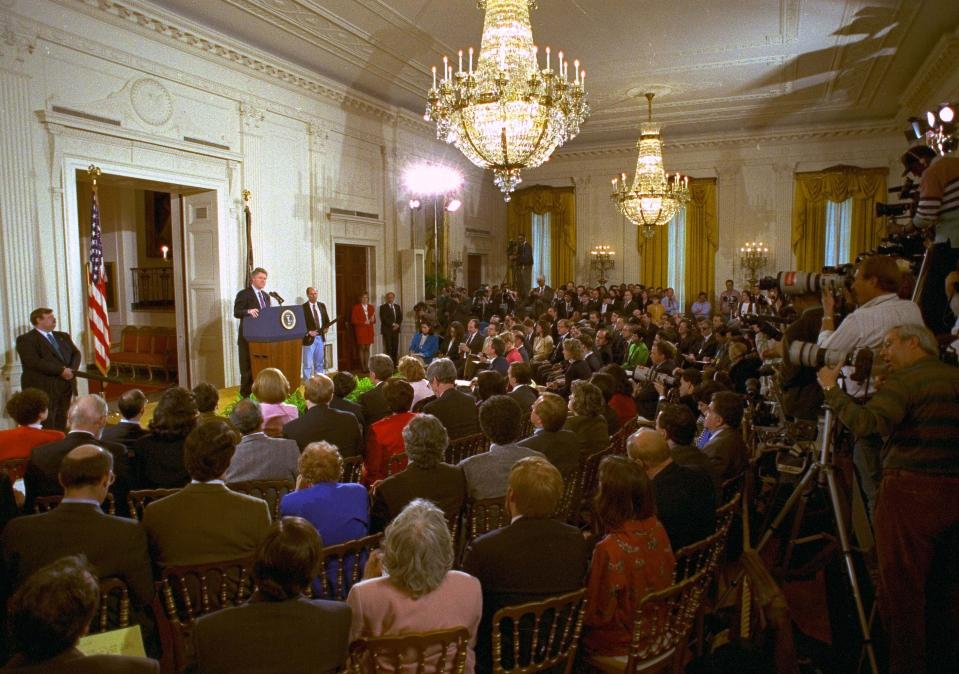 FILE - In this March 23, 1993, file photo, members of the media fill the East Room of the White House during President Bill Clinton's first formal news conference since taking office. (AP Photo/Marcy Nighswander, File)