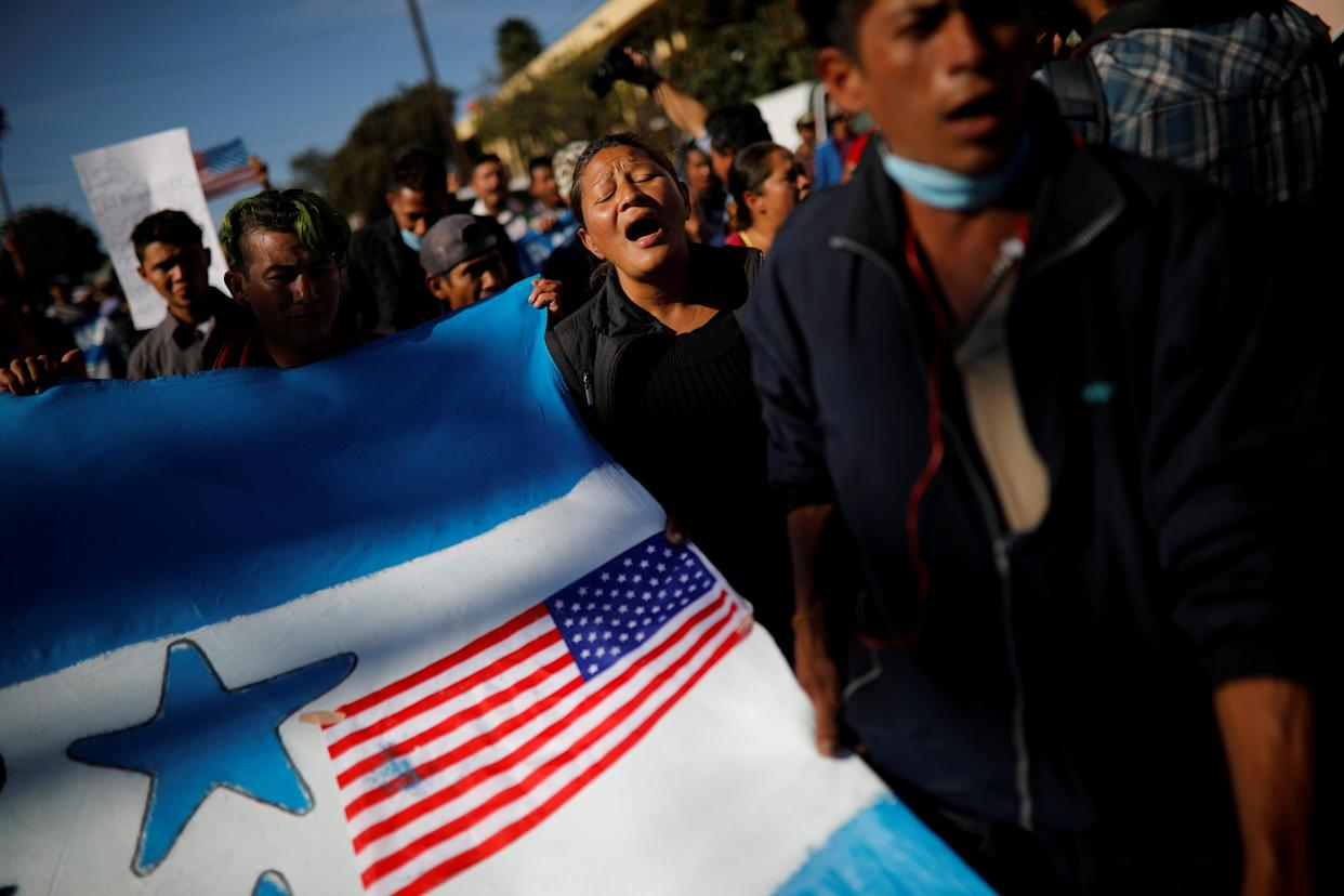 Migrants, part of a caravan of thousands traveling from Central America en route to the United States, take part in a protest march towards the border wall between the U.S. and Mexico, in Tijuana, Mexico November 25, 2018. (Photo: Alkis Konstantinidis/Reuters)