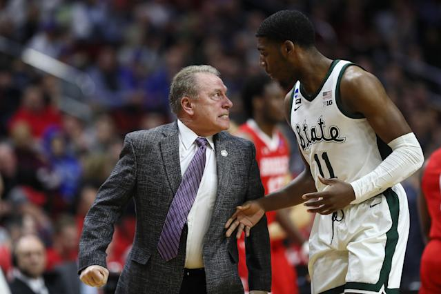 Head coach Tom Izzo of the Michigan State Spartans glares at Aaron Henry #11 after a play during their win Thursday. (Getty)