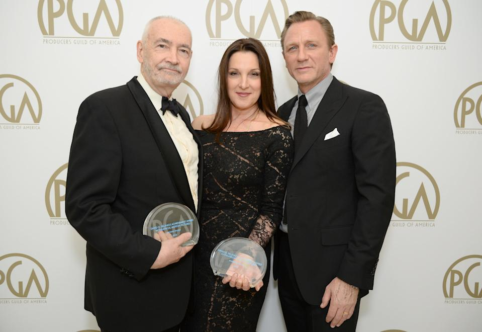 Michael G. Wilson and Barbara Broccoli pose with the David O. Selznick award and Daniel Craig backstage at the 25th annual Producers Guild of America (PGA) Awards 2014. (Photo by Jordan Strauss/Invision for Producers Guild/AP Images)