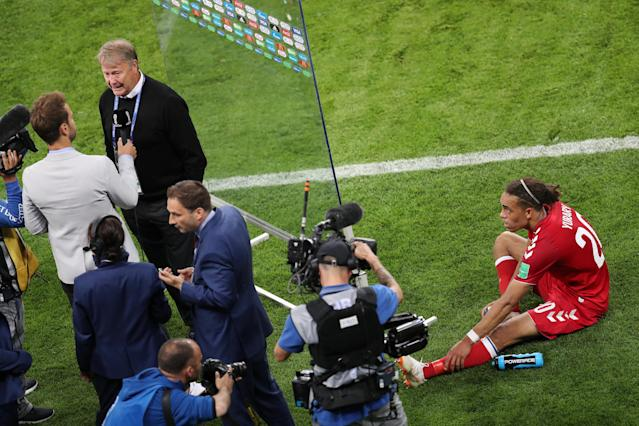 Soccer Football - World Cup - Group C - Peru vs Denmark - Mordovia Arena, Saransk, Russia - June 16, 2018 Denmark's Yussuf Poulsen sits on the pitch as coach Age Hareide talks with the media after the match REUTERS/Ricardo Moraes