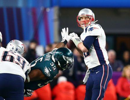 Feb 4, 2018; Minneapolis, MN, USA; Philadelphia Eagles defensive end Brandon Graham (55) sacks New England Patriots quarterback Tom Brady (12) forcing a fumble in the fourth quarter in Super Bowl LII at U.S. Bank Stadium. Mandatory Credit: Mark J. Rebilas-USA TODAY Sports