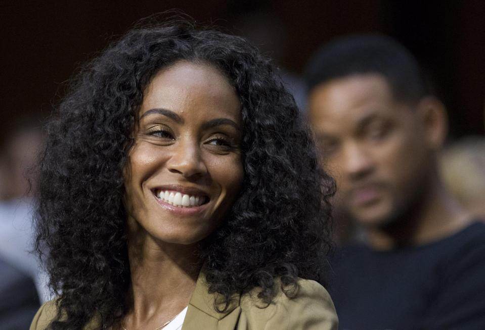 """Jada Pinkett Smith, accompanied by her actor husband Will Smith, testifies before the Senate Foreign Relations Committee during a hearing on """"The Next Ten Years in the Fight Against Human Trafficking: Attacking the Problem with the Right Tools"""" on Capitol Hill in Washington Tuesday, July 17, 2012. (AP Photo/Manuel Balce Ceneta)"""