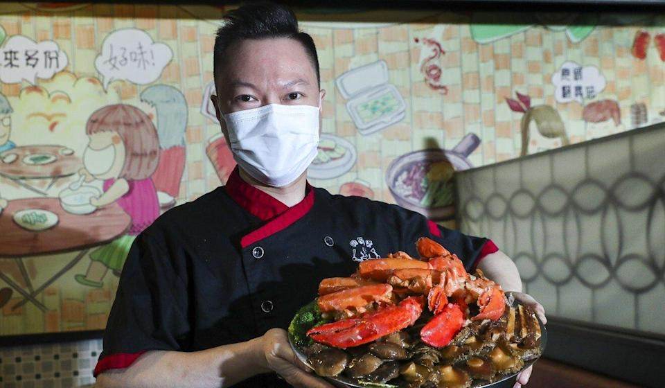 Chef Bentley Mok of Happy Together Hotpot in Kowloon City shows off his restaurant's version of poon choi. Photo: Edmond So