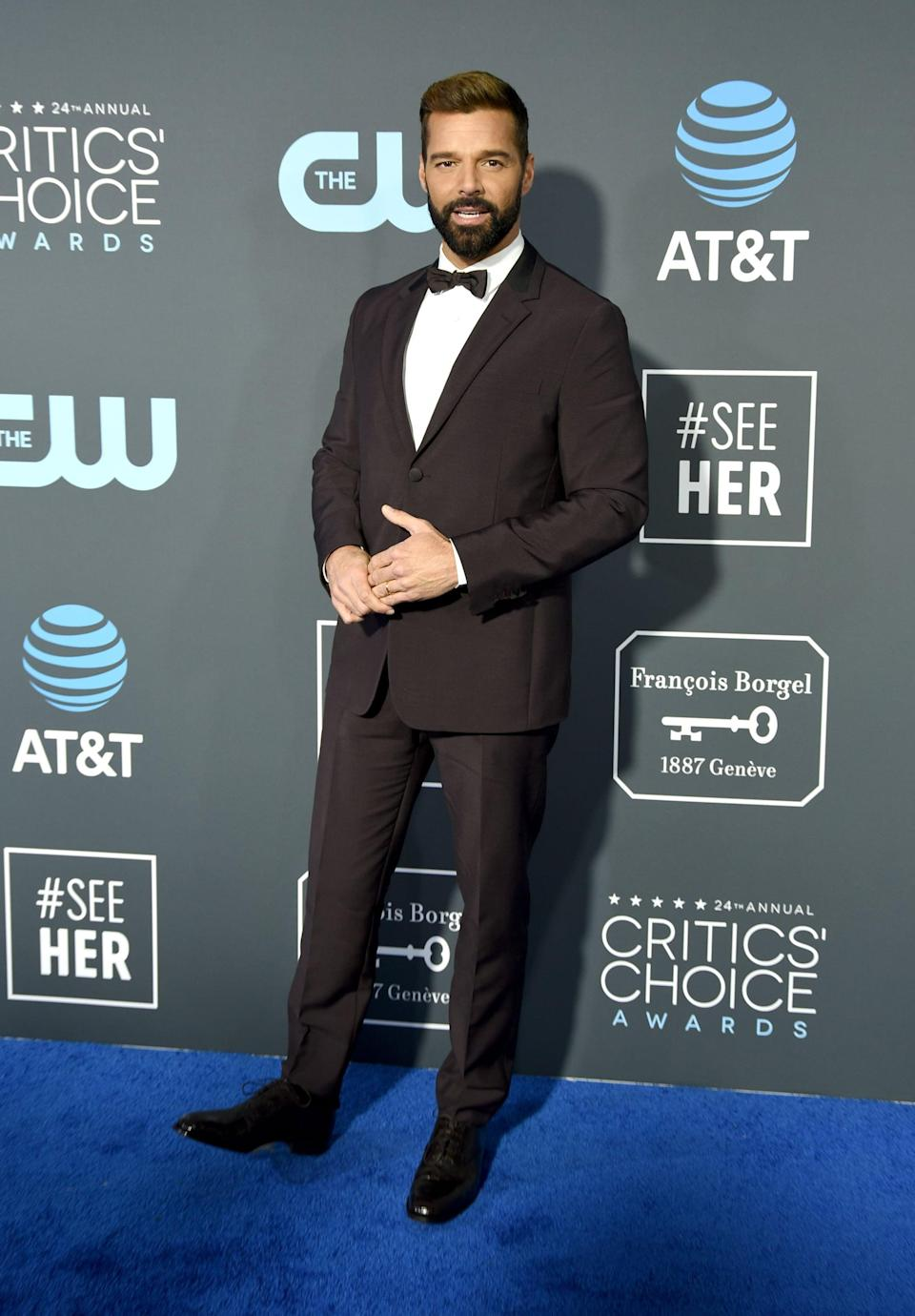 <p>Ricky Martin wearing a black suit.</p>