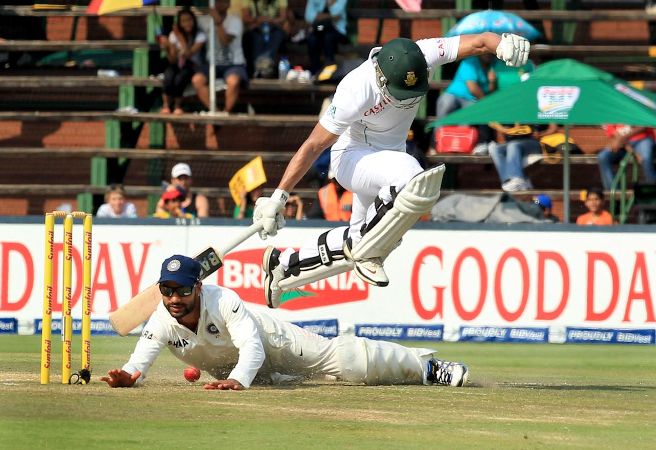South African batsman Alviro Petersen jumps to avoid collision with Indian player Shikhar Dhawan on the fourth day of 1st Test match between India and South Africa at Wanderers in Johannesburg on 21 Dec 2013. (Photo: IANS)