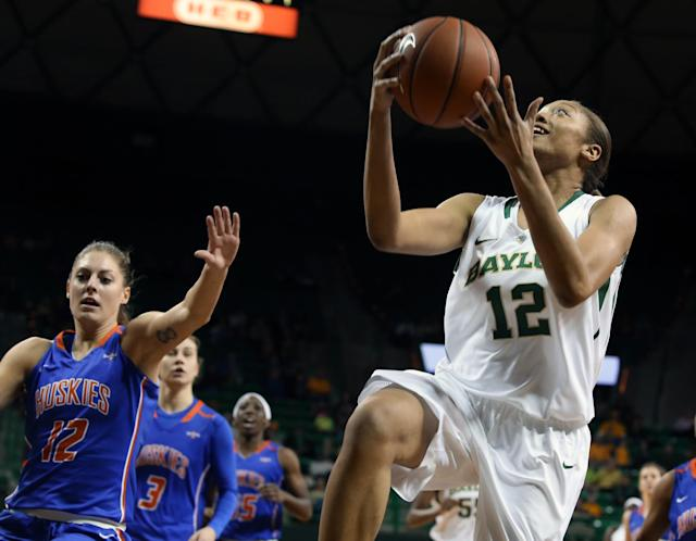 Baylor guard Alexis Prince (12) drives past Houston Baptist guard Wiebke Bruns (12), left, in the first half of an NCAA college basketball game, Sunday, Dec. 15, 2013, in Waco, Texas. (AP Photo/The Waco Tribune Herald, Rod Aydelotte)