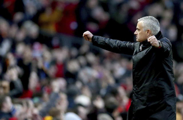 Manchester United manager Jose Mourinho celebrates after Juan Mata scores his side's second goal of the game during their English Premier League soccer match against Fulham at Old Trafford, Manchester, England, Saturday, Dec. 8, 2018. (Barrington Coombs/PA via AP)
