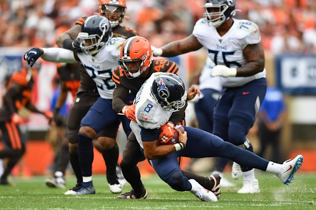 Marcus Mariota #8 of the Tennessee Titans is sacked by Morgan Burnett #42 of the Cleveland Browns in the second quarter at FirstEnergy Stadium on September 08, 2019 in Cleveland, Ohio . (Photo by Jamie Sabau/Getty Images)