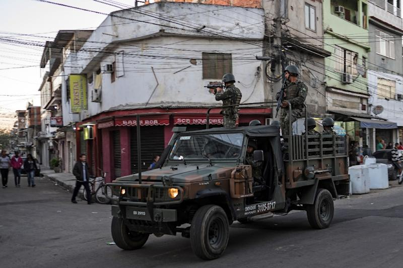 Marines leave the Mare favela complex on June 30, 2015, over a year after being deployed to ramp up security in the area