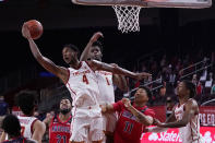 Southern California forward Evan Mobley (4) grabs a rebound over Arizona forward Ira Lee (11) during the first half of an NCAA college basketball game Saturday, Feb. 20, 2021, in Los Angeles. (AP Photo/Marcio Jose Sanchez)