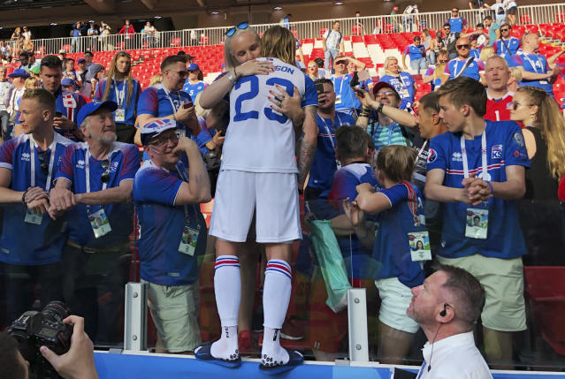Iceland's Ari Skulason hugs a woman after a draw during the group D match between Argentina and Iceland at the 2018 soccer World Cup in the Spartak Stadium in Moscow, Russia, Saturday, June 16, 2018. (AP Photo/Matthias Schrader)
