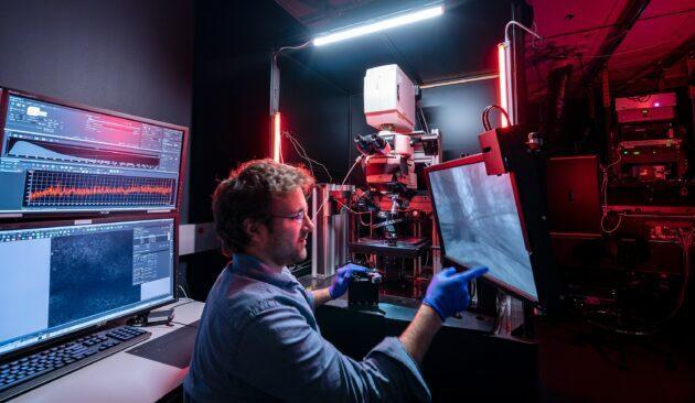The Allen Institute's Jerome Lecoq, one of the lead authors of a mouse-brain study, works on one of the 2-photon microscopes that was used to record neural activity in more than 200 mice. (Allen Institute Photo)
