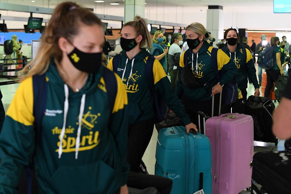 Australian softball players queue at the check-in counter prior to their departure for the Tokyo Olympics, at Sydney International Airport on May 31, 2021. (Photo by SAEED KHAN / AFP) (Photo by SAEED KHAN/AFP via Getty Images)