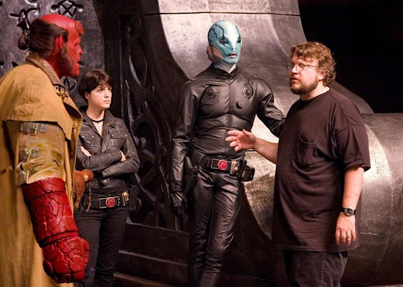 Guillermo del Toro with Ron Perlman as Hellboy, Selma Blair as Liz Sherman and Doug Jones as Abe Sabien on the set of 2008's 'Hellboy II: The Golden Army' (credit: Universal)