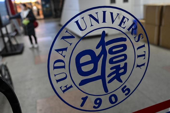 A Fudan University logo is seen on a glass door on the campus in Shanghai.