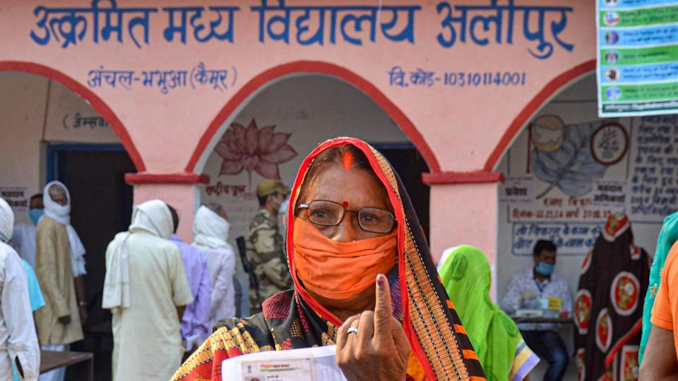 A voter shows her finger marked with indelible ink after casting her vote for the first phase of Bihar Assembly Election, amid the coronavirus pandemic, at Bhabua police station in Kaimur district, Wednesday, 28 October.