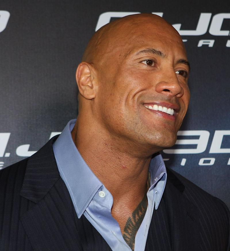 Dwayne Johnson smiling at a publicity shoot