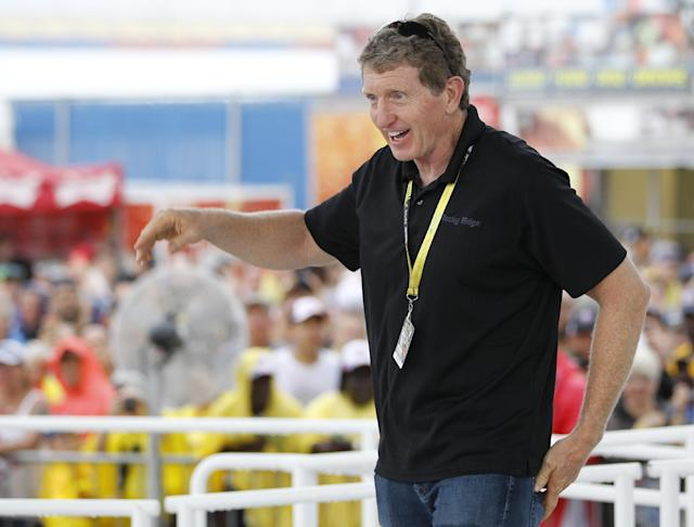 Former NASCAR champion Bill Elliott comes on stage in the Fan Zone to greet Dale Earnhardt Jr. before the Sprint cup Series auto race at Daytona International Speedway in Daytona Beach, Fla., Saturday, July 5, 2014. (AP Photo/Terry Renna)
