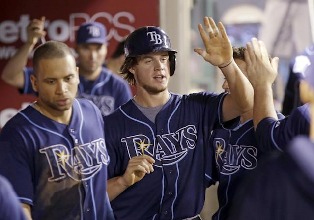 Tampa Bay Rays' Wil Myers celebrates scoring against the Los Angeles Angels in the seventh inning of a baseball game in Anaheim, Calif., Tuesday, Sept. 3, 2013. (AP Photo/Reed Saxon)