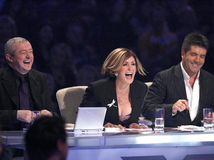 Louis Walsh, Sharon Osbourne and Simon Cowell at the judges' table on 'The X Factor' in 2005 (Ken McKay/Shutterstock)
