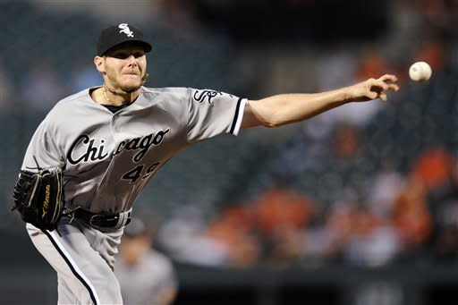 Chicago White Sox starting pitcher Chris Sale delivers against the Baltimore Orioles during the second inning of a baseball game, Tuesday, Aug. 28, 2012, in Baltimore. (AP Photo/Nick Wass)