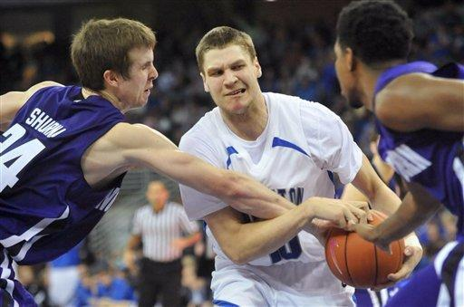 Northwestern's John Shurna (24) tries to steal the ball from Creighton's Grant Gibbs (10) during an NCAA college basketball game in Omaha, Neb., Thursday, Dec. 22, 2011. (AP Photo/Dave Weaver)