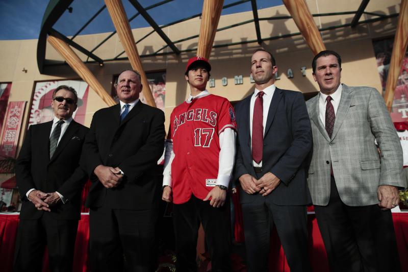 Shohei Ohtani, center, at his introductory press conference with the Angels in December. (AP)