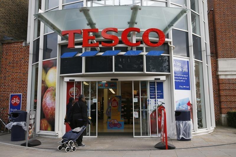 A woman enters a Tesco store in south London