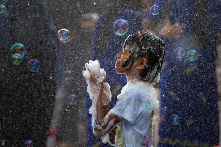 Public water fights are part of a cleansing ritual to welcome in the Buddhist new year and are also held in Thailand, Cambodia and Laos
