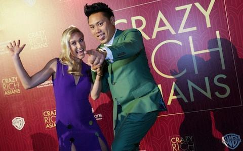"""<span>Director John Chu and his wife Kristin Hodge pose for photographers as they arrive for the red carpet screening of the movie """"Crazy Rich Asians"""" on Tuesday</span> <span>Credit: Don Wong/AP </span>"""