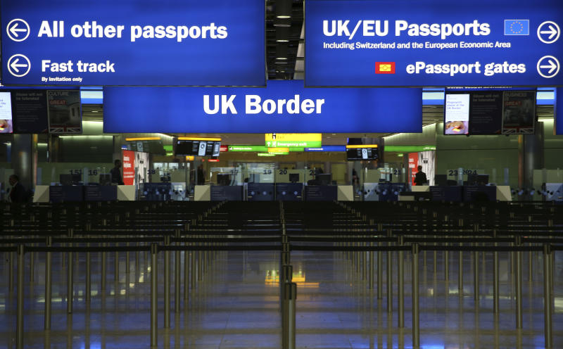 UK Border control is seen in Terminal 2 at Heathrow Airport in London June 4, 2014. REUTERS/Neil Hall