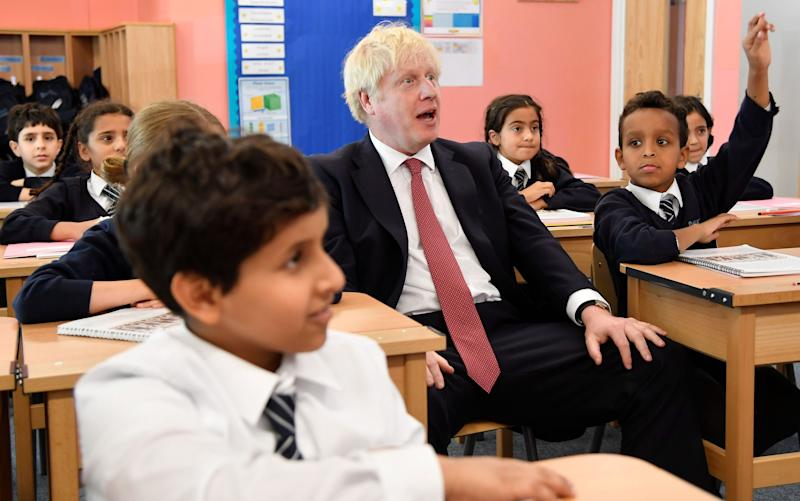 Listening mode? Boris Johnsonattends a year four history class in south London yesterday - AFP