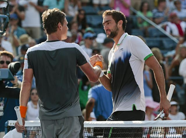 Marin Cilic, of Croatia, right, greets Tomas Berdych, of the Czech Republic, at the net after winning their quarterfinal match of the 2014 U.S. Open tennis tournament, Thursday, Sept. 4, 2014, in New York. (AP Photo/Julio Cortez)
